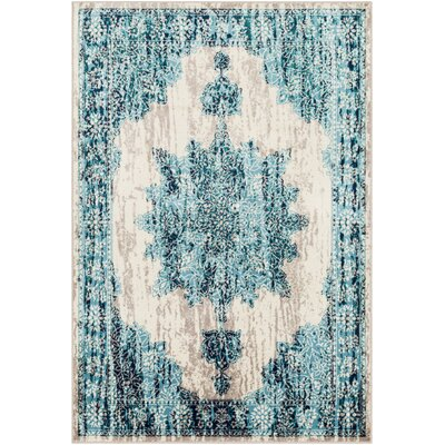 Ramsay Distressed Floral Bright Blue/Taupe Area Rug Rug Size: Rectangle 67 x 96