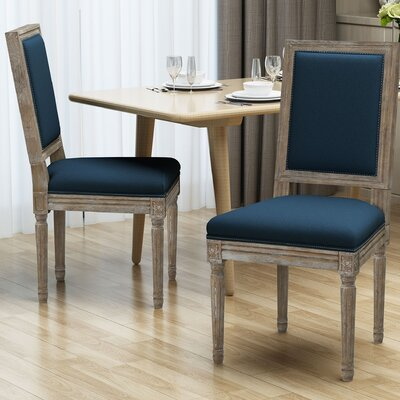 Viveiros Upholstered Dining Chair Upholstery Color: Blue