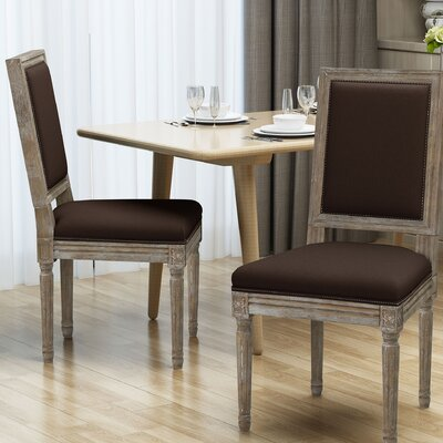 Viveiros Upholstered Dining Chair Upholstery Color: Brown