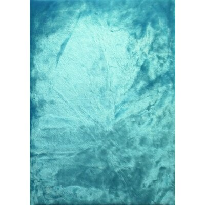 Theydon Faux Fur Turquoise Area Rug