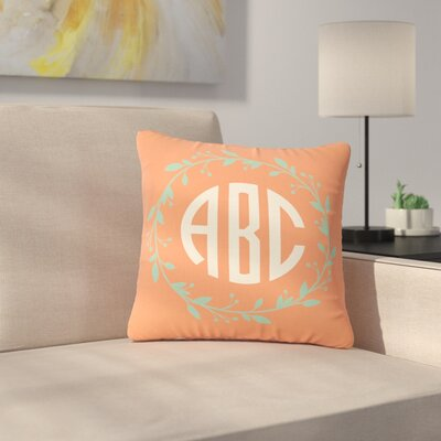 Classic Cream Wreath Monogram Typography Outdoor Throw Pillow Size: 18 H x 18 W x 5 D, Color: Red