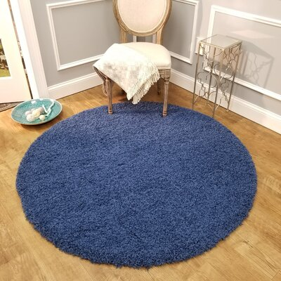 Komar Solid Navy Area Rug Rug Size: Round 5
