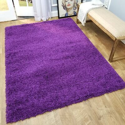 Komar Solid Purple Area Rug Rug Size: Rectangle 67 x 93
