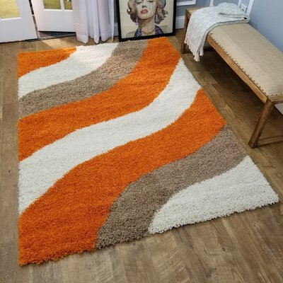 Komar Striped Gray/Orange Area Rug Rug Size: Rectangle 67 x 93