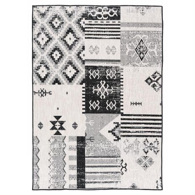 Tseng Reversible Black/White Indoor/Outdoor Area Rug Rug Size: Rectangle 53 x 76