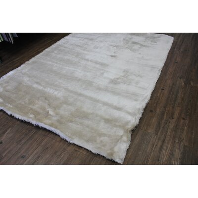 Patchell Hand-Tufted Beige Area Rug