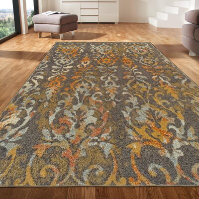 Clemmie Tan/Orange Area Rug Rug Size: Rectangle 5 x 8