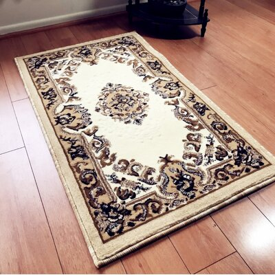 Edgardo Traditional Ivory Area Rug Rug Size: Rectangle 4 x 6
