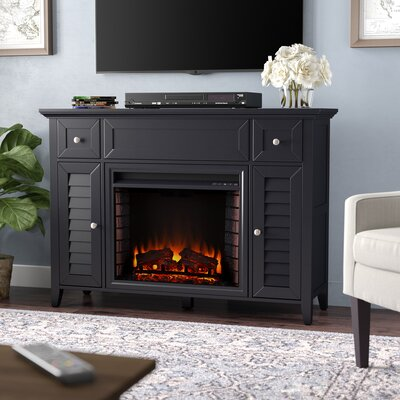 Cherrywood Entertainment Center with Electric Fireplace Finish: Black
