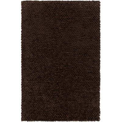 Janey Hand-Woven Chocolate Area Rug Rug Size: 79 x 106