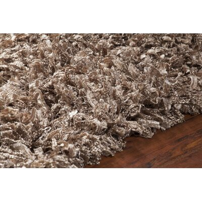 Funkhouser Hand-Woven Brown Area Rug Rug Size: 79 x 106