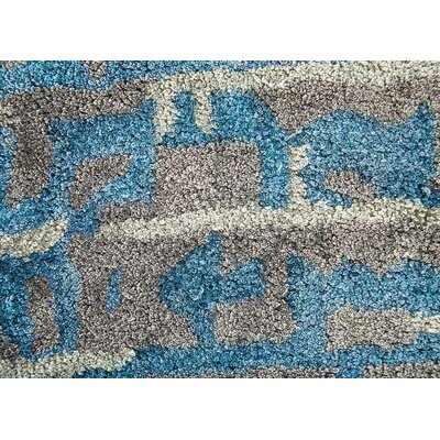 Elisha Hand-Tufted Blue/Taupe Area Rug Rug Size: Rectangle 5 x 8