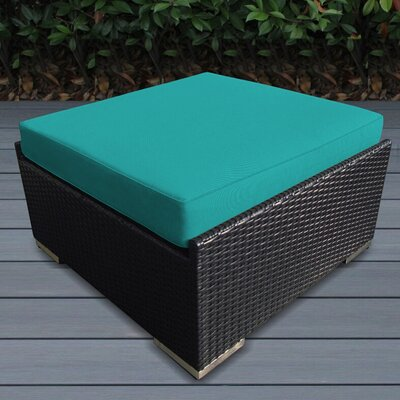 Jasmin Small Ottoman with Cushion Fabric: Turquoise, Finish: Black