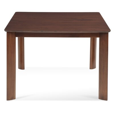 Burhan Rectangular Wood Dining Table Finish: Walnut, Table Top: Strata Top