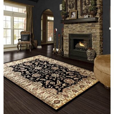 Rasmussen Traditional Black/Beige Area Rug Rug Size: 5 x 8