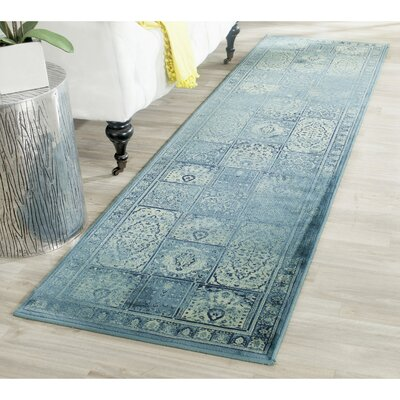 Audrey Vintage Turquoise Area Rug Rug Size: 67 x 92
