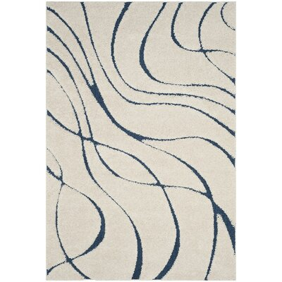 Enrique Cream/Blue Area Rug Rug Size: Rectangle 6 x 9