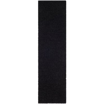 Cherlyn Black Area Rug