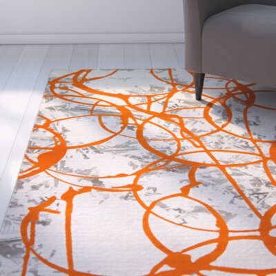 Tricia Orange/Gray Area Rug Rug Size: 52 x 72