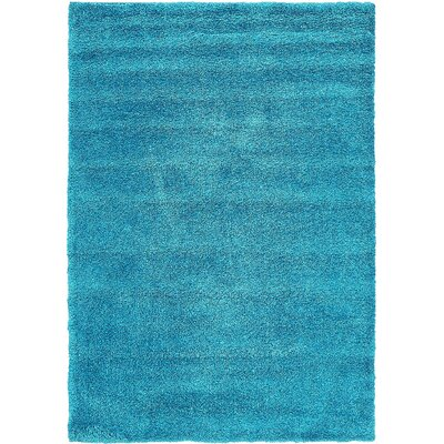 Truett Turquoise Area Rug Rug Size: Rectangle 5 x 77