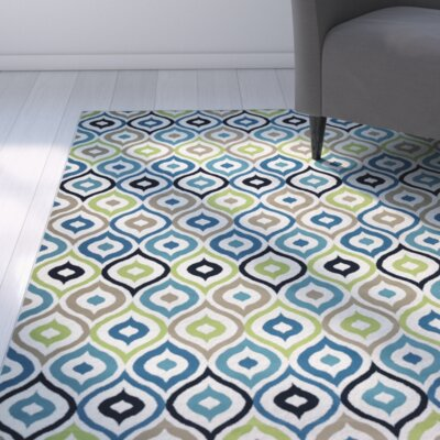 Lucia Ivory/Navy Indoor/Outdoor Area Rug Rug Size: 67 x 96