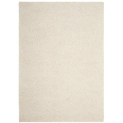 Schmitt Rectangle Beige Area Rug Rug Size: 51 x 76