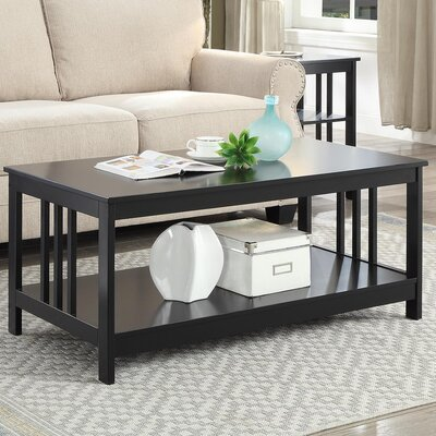Evelynn Coffee Table with Magazine Rack Finish: Black