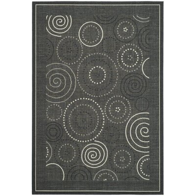 Mullen Black/Sand Circle Outdoor Rug Rug Size: 53 x 77