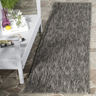 Estella  Black Indoor/Outdoor Area Rug Rug Size: 4 x 57
