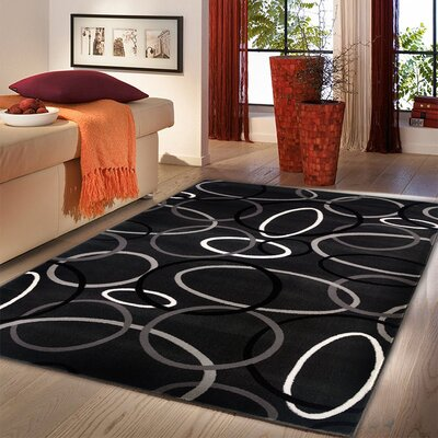 Browning Rings Charcoal Area Rug Rug Size: 92 x 126