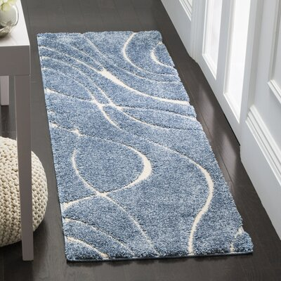 Enrique Blue/Cream Area Rug Rug Size: 33 x 53