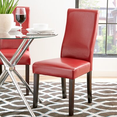 Jodie Curved-Back Dining Chair Upholstery: Red Faux Leather