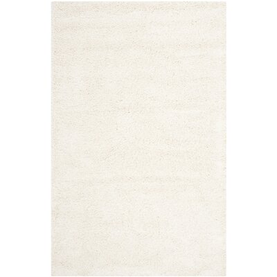 Holliday Solid Ivory Area Rug Rug Size: Rectangle 51 x 8