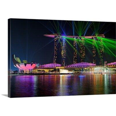 "'Marina Bay Sands Laser-show by Martin Fleckenstein Photographic Print Format: Black Frame, Size: 21"" H x 29"" W x 1"" D 2352154_15_24x16_none"