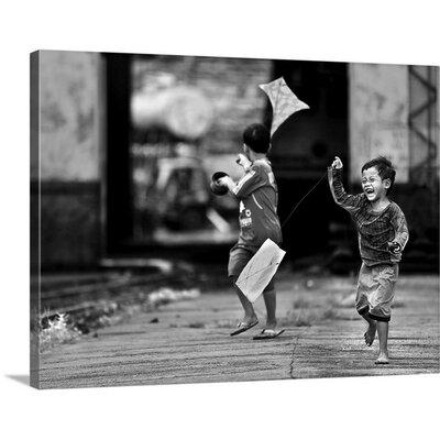 "The Kite Runner by Sebastian Kisworo Photographic Print on Canvas Size: 36"" H x 48"" W x 1.5"" D"