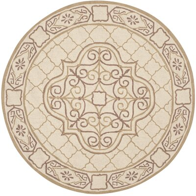 Apache Hand-Hooked Ivory & Gold Area Rug Rug Size: Round 6 x 6