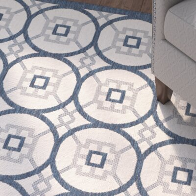 Raymond Beige/Navy Indoor/Outdoor Area Rug Rug Size: 67 x 96