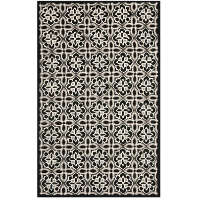 Doyle Black/Ivory Outdoor Area Rug Rug Size: Rectangle 5 x 8
