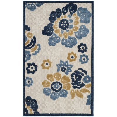 Ennis Ivory/Blue Indoor/Outdoor Area Rug Rug Size: 33 x 53