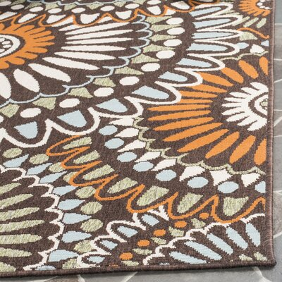 Tierney Chocolate & Terracotta Outdoor Area Rug Rug Size: 8 x 112