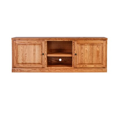 Traditional 67 Knob TV Stand Color: Red Oak