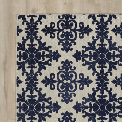 Clarence Ivory / Navy Indoor/Outdoor Area Rug Rug Size: 53 x 77