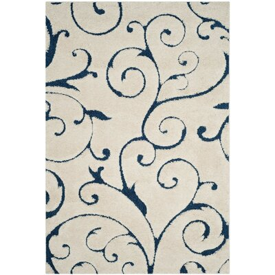 Alison Cream/Navy Blue Area Rug Rug Size: 53 x 76