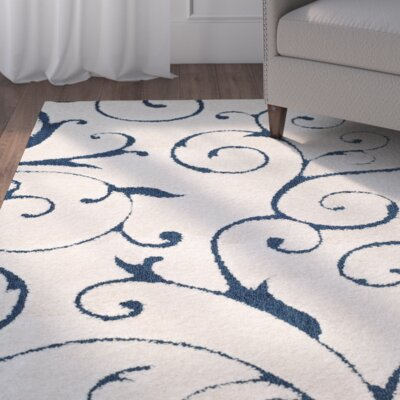 Alison Cream/Navy Blue Area Rug Rug Size: 11 x 15