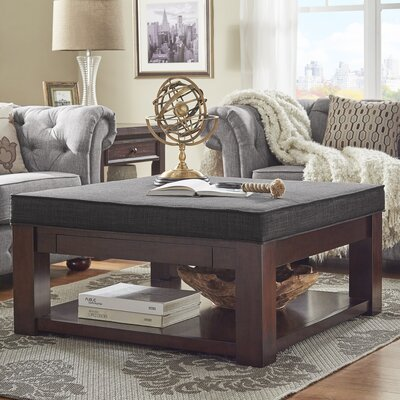 Back East Cross Cushion Ottoman Color: Dark Gray, Base Finish: Espresso