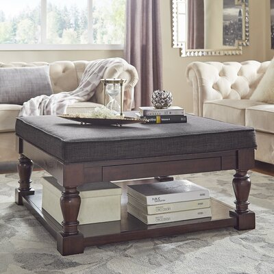 Back East Cross Cushion Ottoman Upholstery: Dark Gray, Base Finish: Espresso