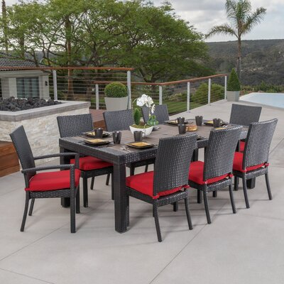 Evansville 9 Piece Outdoor Dining Set with Cushion Cushion Color: Sunset Red