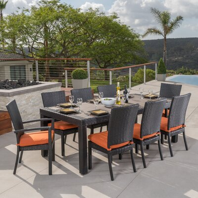 Evansville 9 Piece Outdoor Dining Set with Cushion Cushion Color: Tikka Orange