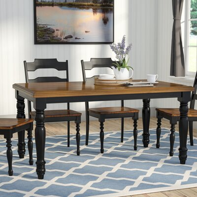 Courtdale Dining Table Table Finish: Almond / Ebony