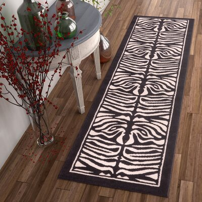 Dulcet Ivory & Black Zebra Area Rug Rug Size: 33 x 53